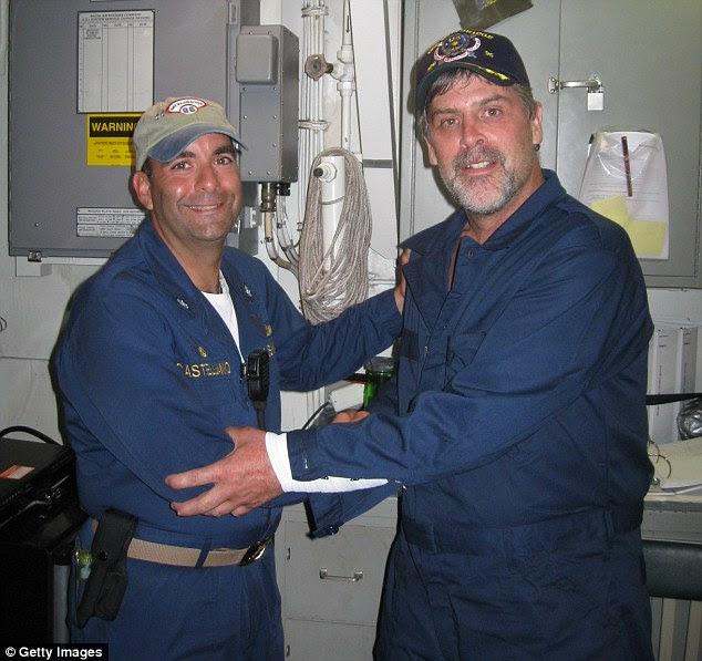 Rescue: Captain Phillips, right, with Commander Frank Castellano of the USS Bainbridge