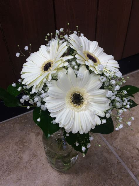 White gerbera daisy bouquet with baby's breath and greens