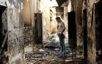 An employee of Doctors Without Borders, MSF, walks inside the charred remains of the organization's hospital after it was hit by a U.S. airstrike in Kunduz, Afghanistan. (AP/Najim Rahim)