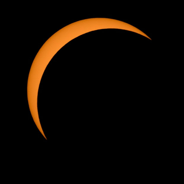 The moon is seen passing in front of the sun during a solar eclipse from Ross Lake, Northern Cascades National Park, in Washington on Monday, Aug. 21, 2017. (Bill Ingalls/NASA via AP)