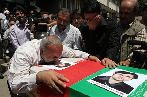 Mourners pay tribute to Iranian Professor Darioush Rezaie, 35, who was gunned down in east Teheran on July 23, 2011. The Iranian government has blamed the United States and the State of Israel for the killing. by Pan-African News Wire File Photos