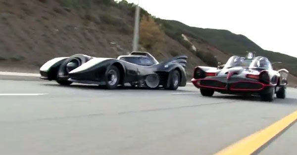 The two Batmobiles cruise along as they try to beat each other to the finish line.