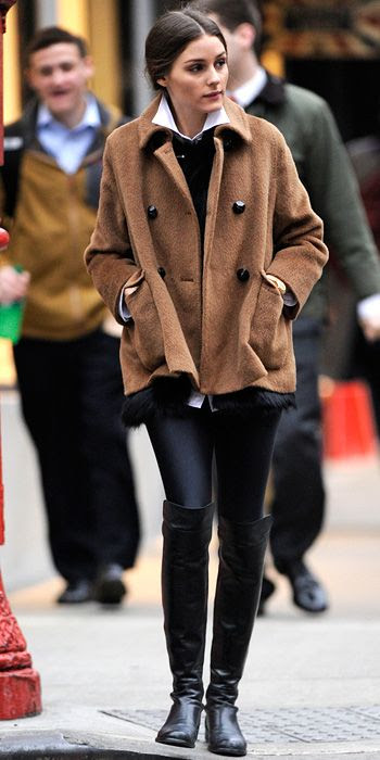 Street Style in Brooklyn by Olivia Palermo. She wore a cozy jacket over leggings and over-the-knee boots.