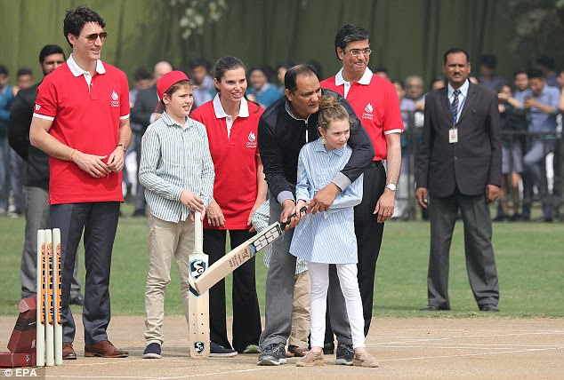 The Prime Minister kept his suit trousers and shoes on but did don a polo shirt as daughterElla-Grace and sonXavier practiced cricket later in the day