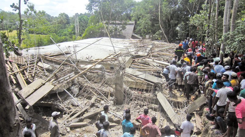 The debris of the collapsed building