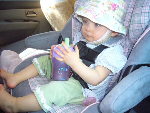 Chilling in the Big Girl Car Seat, with a big girl cup, even