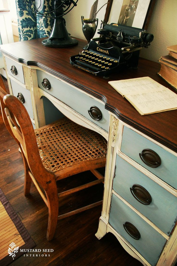 A Painted Desk. Like that the top, body, and drawers are all different colorsstrip the paint off the top, stain it dark...then paint the frame cream and the drawers/inner moldings of cupboard doors in pale blue.
