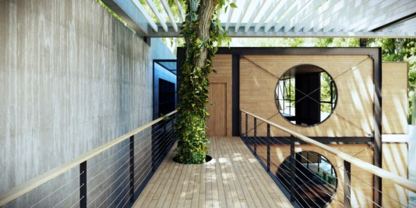 In this design, nature is once again not forgotten. An elevated walkway, made with wood planks, leaves space for trees to grow up and through it, giving shade to the house and offering a spectacular view of the grounds and surrounding areas.