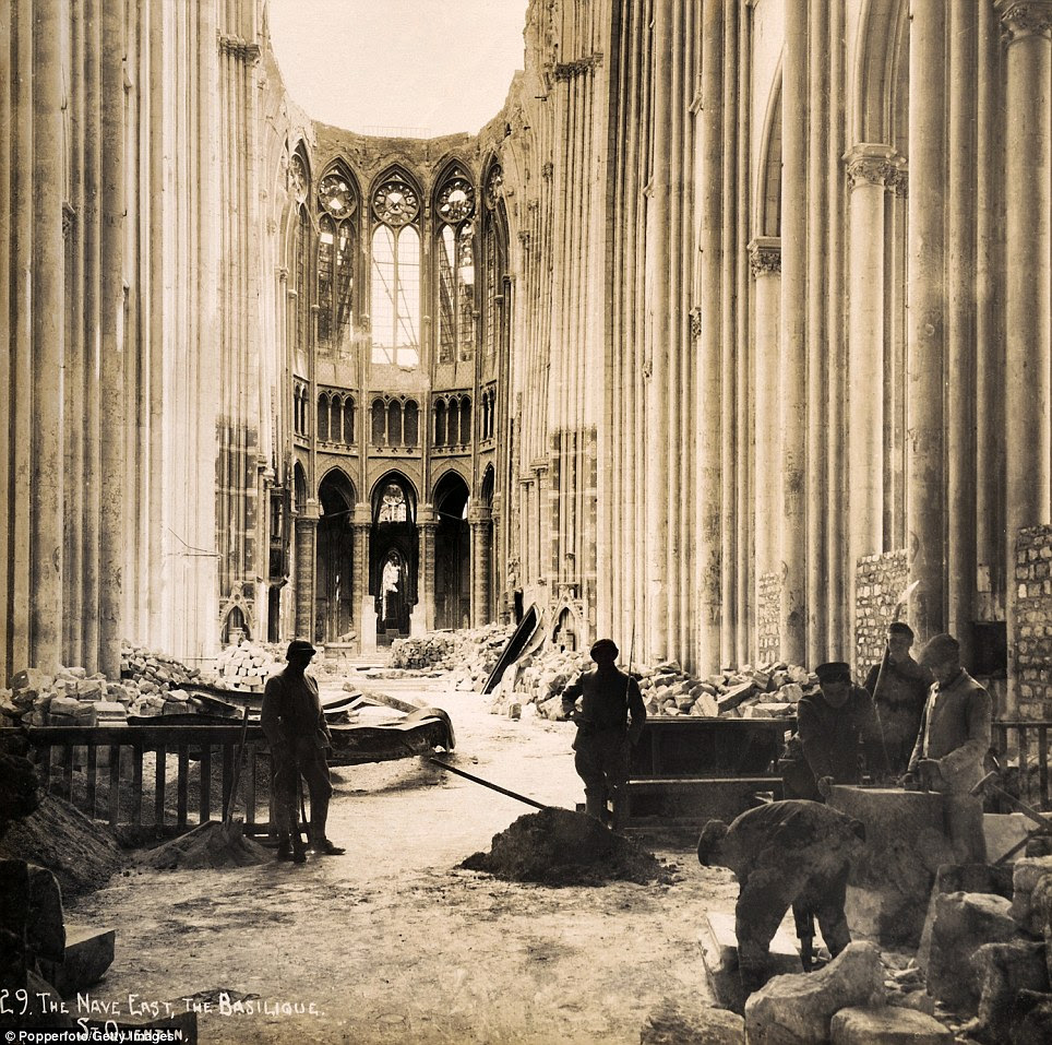 Clear-up effort: The East end of the Nave in the Basilique at Saint-Quentin in Northern France photographed soon after the end of World War One, circa March 1919
