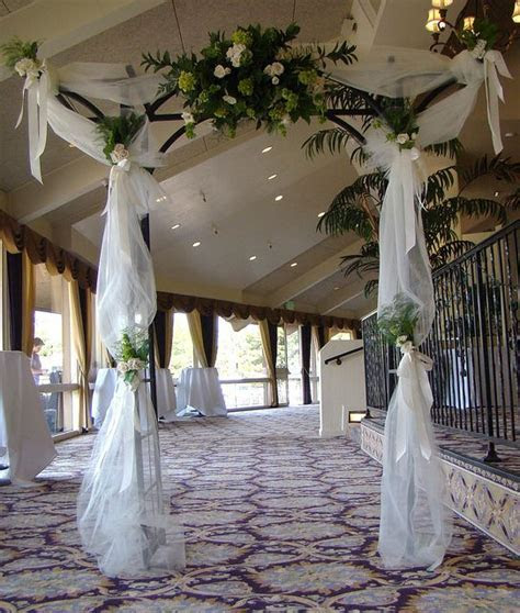 indoor wedding arch decorations   Tulle Covered Wedding