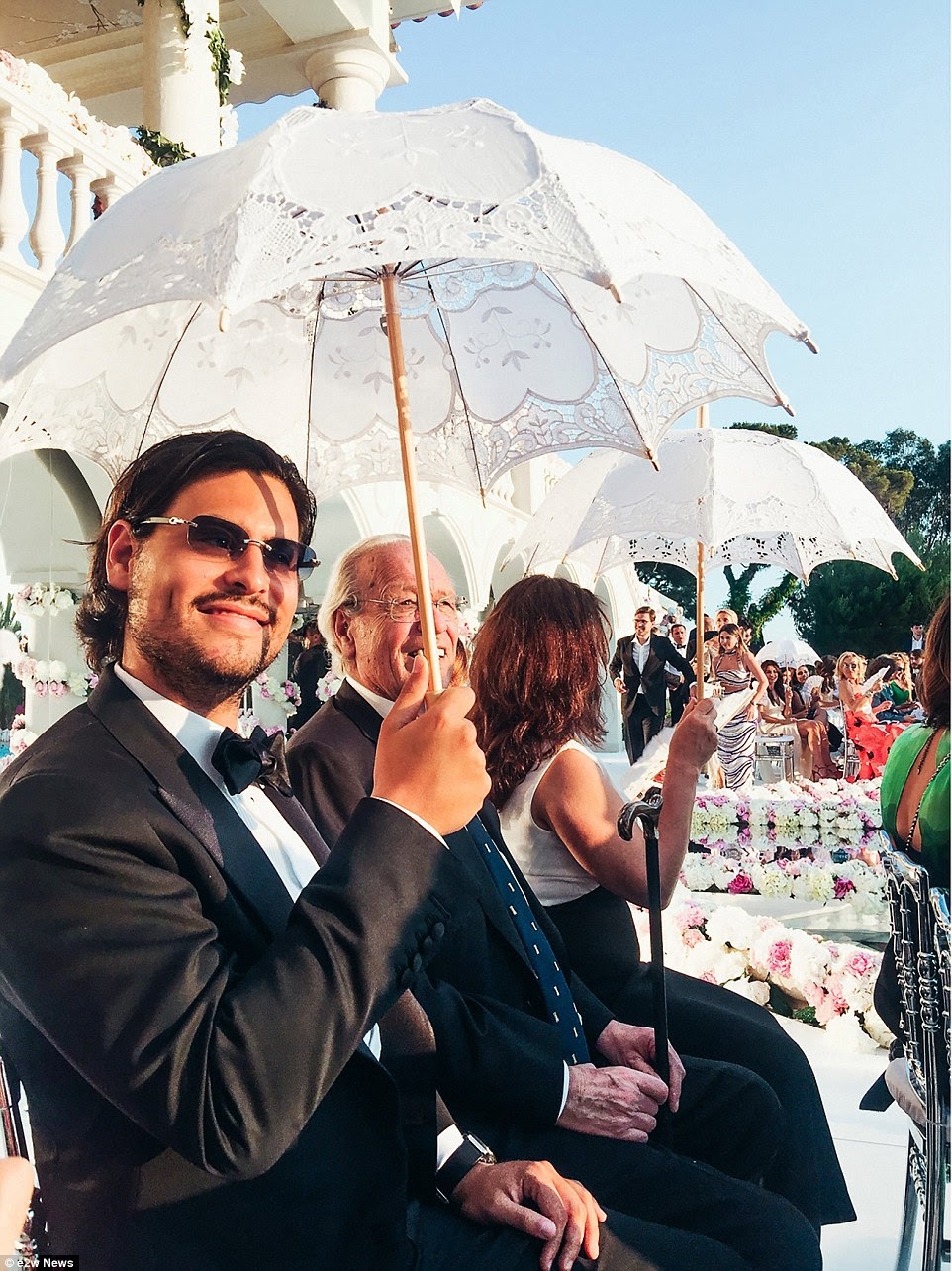 Even the umbrellas oozed money at this French Riviera wedding of a Russian property heiress and the grandson of a Gaddafi henchman