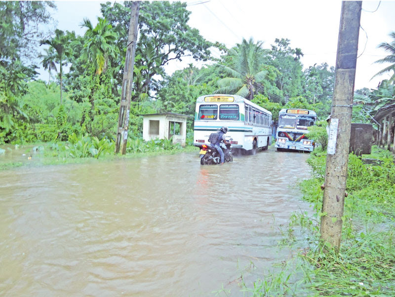 The rainstorm that swept across several parts of the country yesterday caused flash floods in several provinces with the worst affected being the Southern, Western and Sabaragamuwa Provinces. Public transport too became severely affected with some roads getting inundated. The public faced difficulties while the smooth flow of vehicular traffic was hindered with some roads in Meegahatenna in the Kalutara district submerged by the flood waters. Pictures by Meegahathenna Group Correspondent