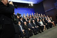 G20 finance ministers and central bank governors gather for a photo at the start of the annual International Monetary Fund and World Bank fall meetings in Washington, October 11, 2013. REUTERS/Jonathan Ernst