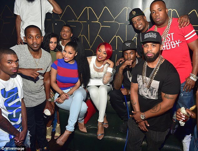 Newly single? Nicki Minaj (in red and blue) attended the afterparty for her Pinkprint Tour in Atlanta on Sunday - with Ruggs, Tracy T, Monica Brown, her reportedly ex-boyfriend Meek Mill, Chubbie Baby and Yo gotti
