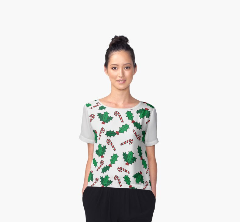 http://www.redbubble.com/people/torriphoto/works/23629587-christmas-design-with-candy-cane-and-holly-berries-pattern?p=chiffon-top&style=chiffon-top&body_color=white