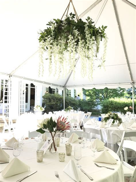 Floral chandelier with greenery and white wisteria