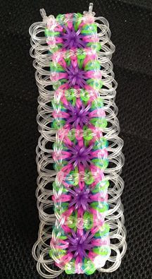 A Large GRANNY pattern bracelet with extra side rings. Pattern by Ellen Carpenter. https://www.youtube.com/watch?v=uzzuxPhsoTY