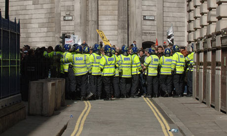 Police hold G20 protesters outside the bank