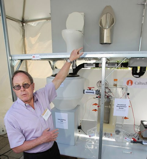 Professor Michael Hoffman of the California Institute of Technology with his team's entry: 'self sustaining photo electrochemical wastewater treatment toilet.'