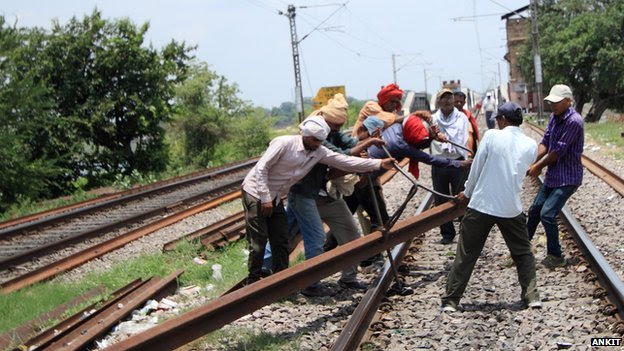 Trackmen are required to replace damaged tracks