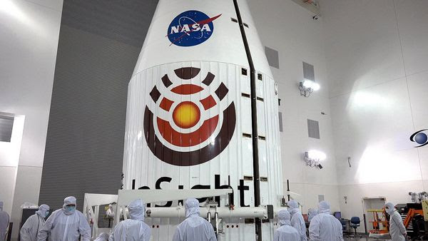 NASA's InSight Mars lander is about to be encapsulated by the Atlas V rocket's payload fairing at Vandenberg Air Force Base in California...on April 16, 2018.