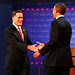 Mitt Romney and President Obama shaking hands before challenging each other on a number of domestic policy issues in their first debate.