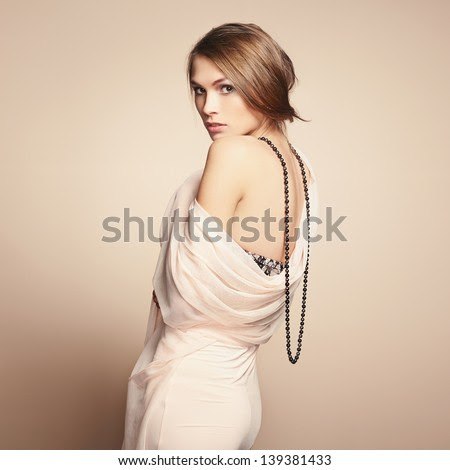 Fashion photo of young beautiful woman. Girl posing. Studio photo