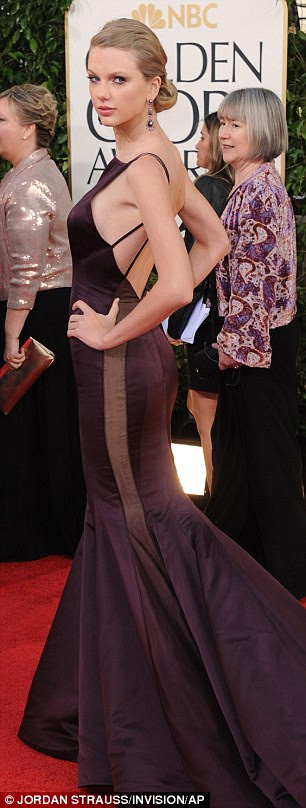 Oh dear, Taylor Swift. She looks positively ancient in this too-dark Donna Karen gown