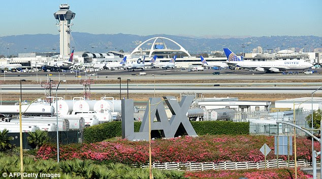 Going nowhere: Hundreds of flights were either cancelled or diverted from Los Angeles Airport, one of the countries biggest airports