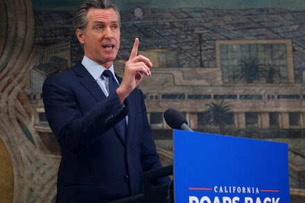 Newsom, facing a $75.5 billion budget surplus and a recall vote, plans a tax rebate for Californians.