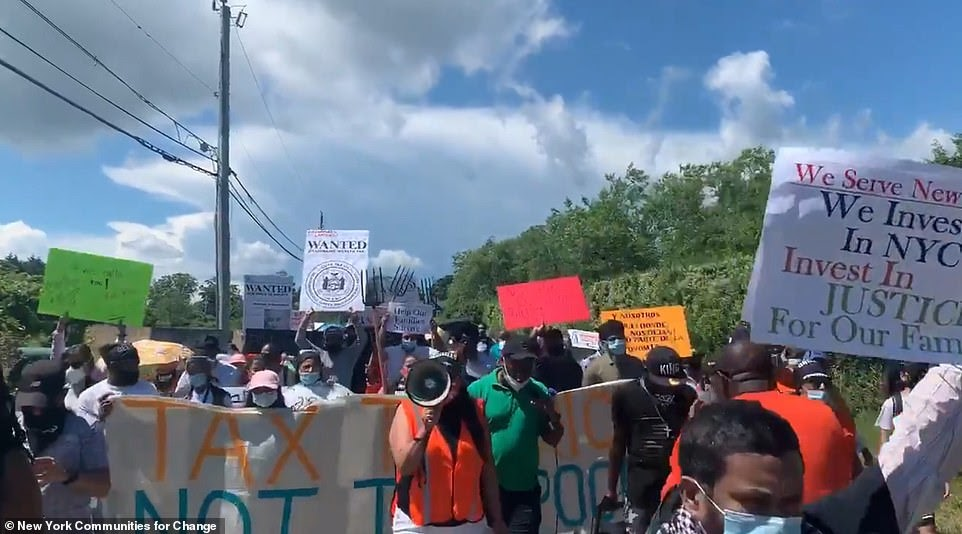 Caravan of protesters wielding plastic pitchforks march through the Hamptons near Michael Bloomberg's $20million estate to demand higher taxes for New York's billionaires (11 Pics)