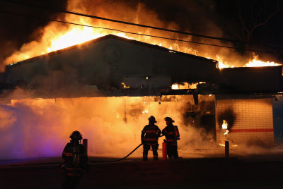 Firefighters fight of flames from a restaurant that was set on fire during the protests in Ferguson. (Scott Olsen/Getty Images)