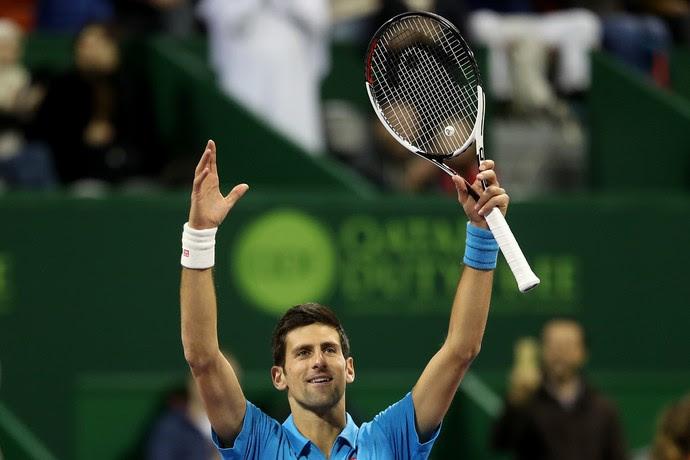 Novak Djokovic comemora vitória sobre Radek Stepanek no ATP de Doha (Foto: KARIM JAAFAR / AFP)