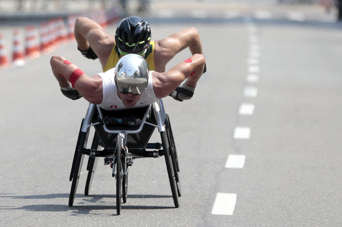 Two racers compete in the wheelchair marathon.