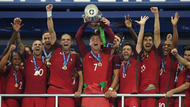 Finally: Cristiano Ronaldo lifts the European Championship trophy for the first time in Portugal's history.