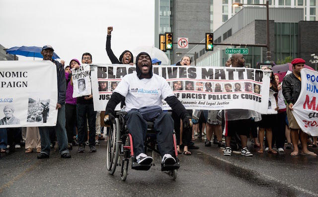 Black man in a 'Black Lives Matter March' in his wheelchair