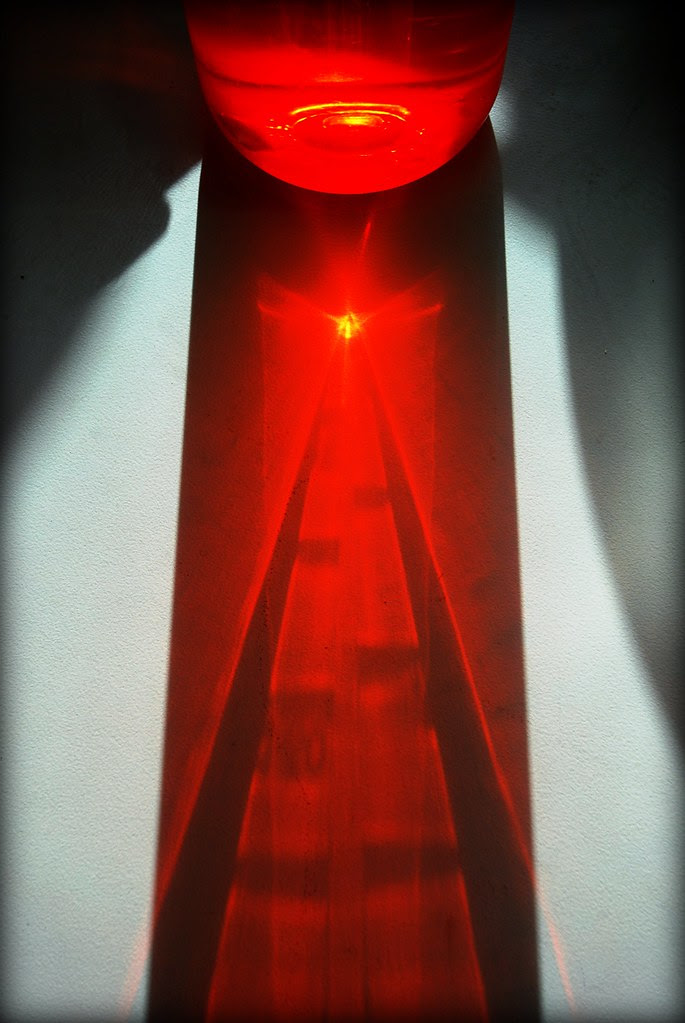 An abstract red composition, with light and shadows.