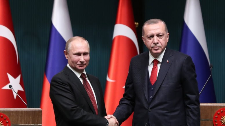 Turkish President Recep Tayyip Erdogan (R) shaking hands with Russian President Vladimir Putin (L) during a press conference after their meeting at the Presidential Palace in Ankara, Turkey 03 April 2018. EPA, TUMAY BERKIN