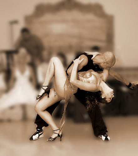 black and white pictures of people dancing. A couple dancing.