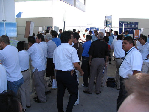 The crazy scene at the Cancun airport - drivers waiting to pick passengers up!