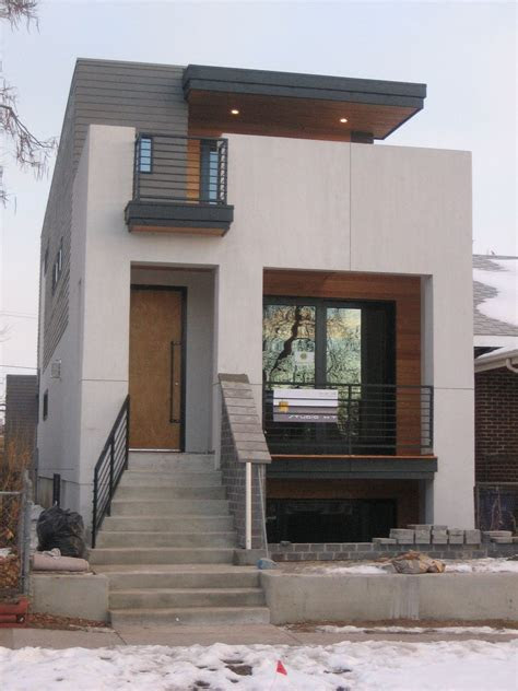 small modern house design  white walol  large