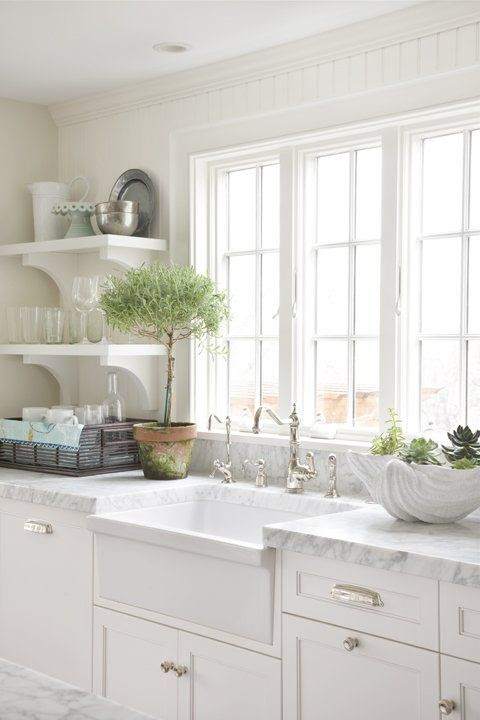 cottage kitchen w/ thick marble counter tops