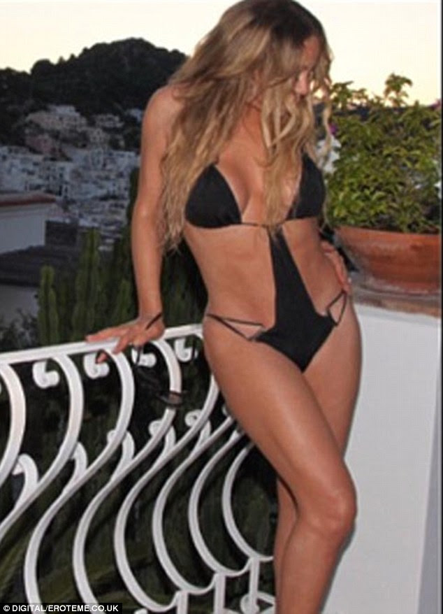 Flawless: Mariah Carey showed off her flawless figure in a black monokini as she shot a new video in Italy with Miguel
