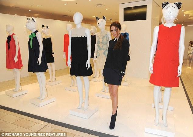 Na demanda: Victoria posou pela sua coleção como ela lançou na Harvey Nichols, que já tem uma lista de espera para clientes ansiosos para colocar as mãos em um de seus projetos