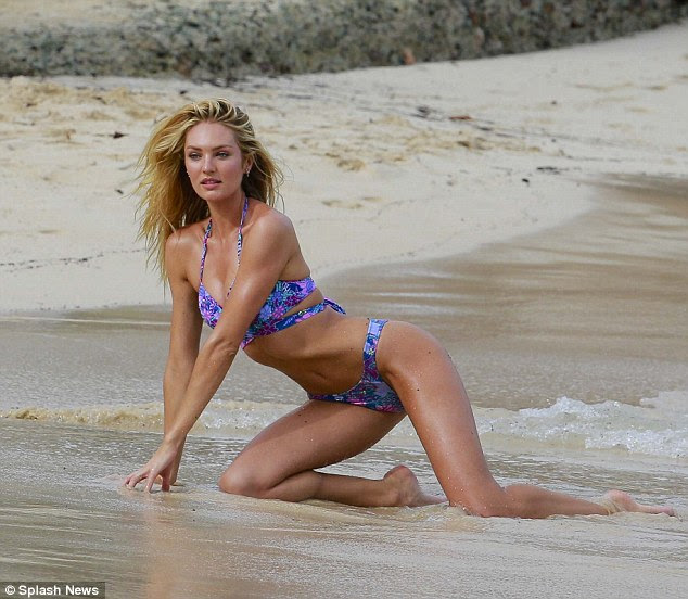 Beach body! Candice flaunted her flawless physique on the coastal front