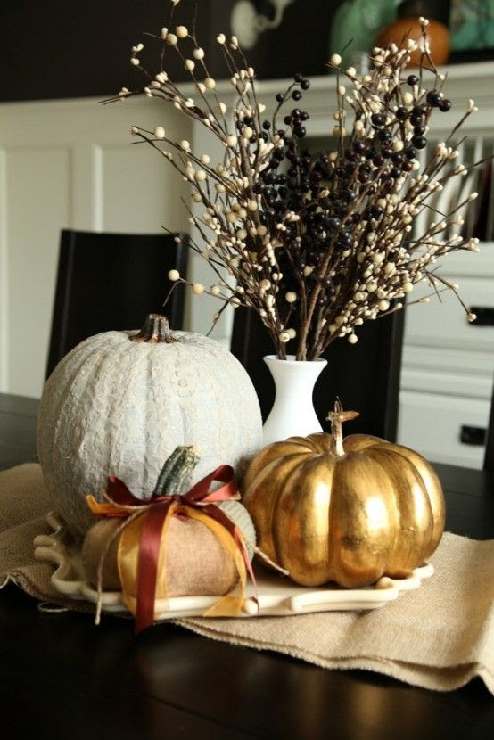 40 Awesome Fall Pumpkin Centerpieces: 40 Fall Pumpkin Centerpieces With black wooden dining table chair stool and golden pumpkin table decor – Momtoob