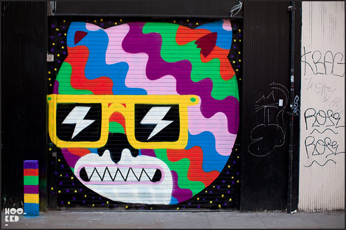 Brick Lane Street Shutter painted by street artist Malarky
