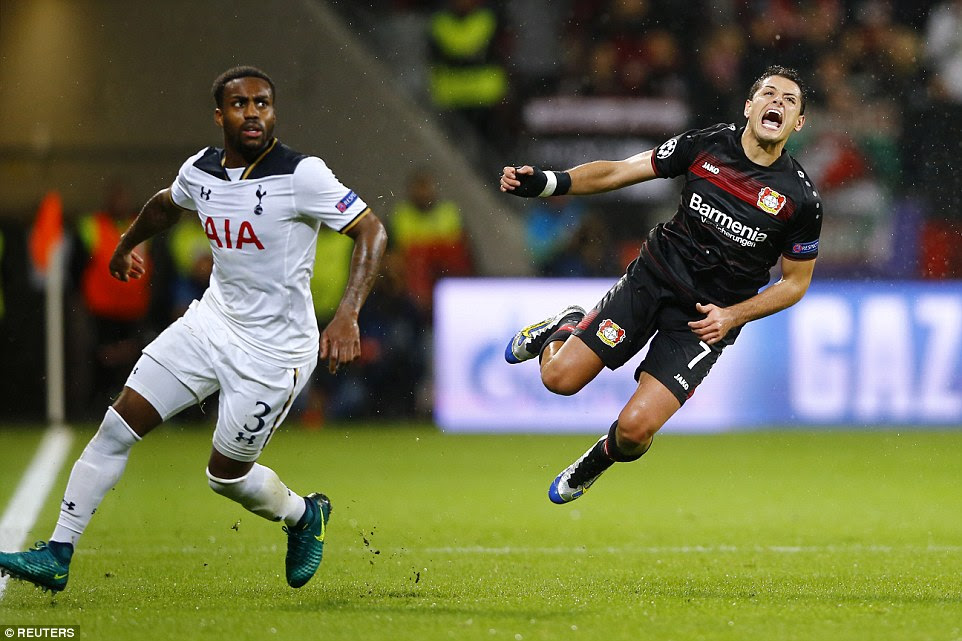 Javier Hernandez flies through the air and screams out under the challenge of Tottenham and England left back Danny Rose