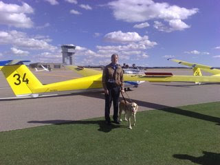 Mike next to a glider on the airfield