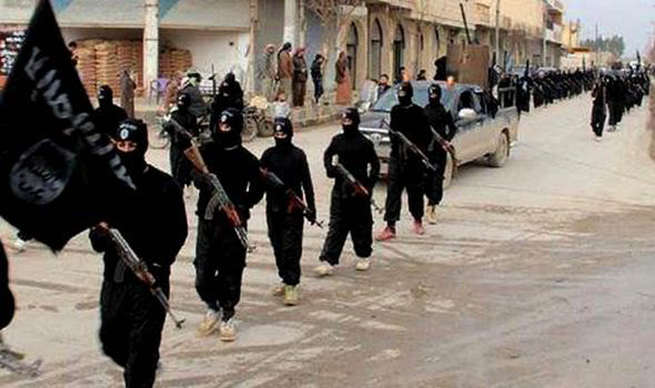 Fighters from Islamic State of Iraq and the Levant pictured marching in Syria